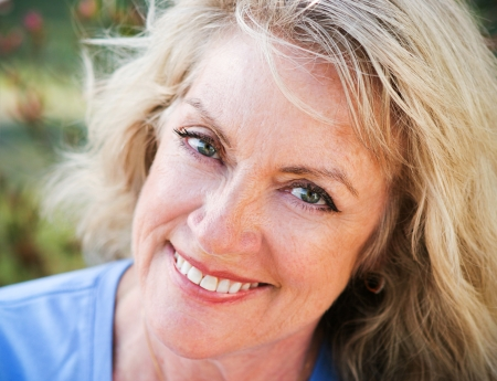 Photo for Beautiful middle-age blond woman, closeup portrait smiling and happy    - Royalty Free Image