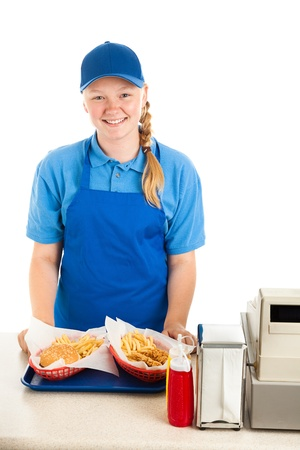 Teenage worker serves meal in a fast food restaurant.  White background