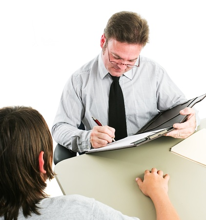 Man interviewing a teenage boy, either for a job, or as a counselor.  White background.