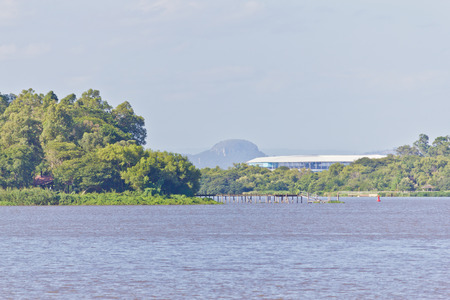Porto Alegre city view with guaiba lake, forest, island and Gremio Arena in background.