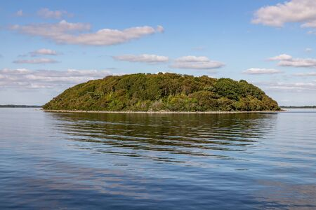 Island, Clouds and reflections in Lough Corrib lake, Cong, Mayo, Irelnd