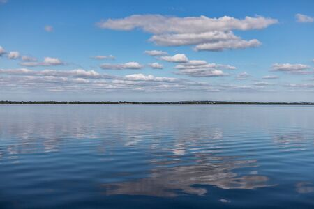 Clouds and reflections in Lough Corrib lake, Cong, Mayo, Irelnd