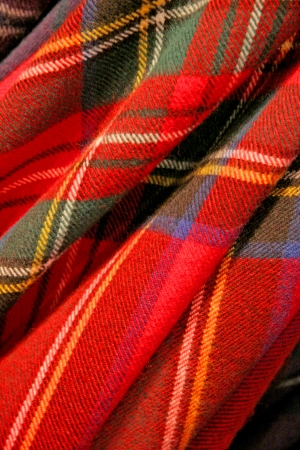 Close up of tartan fabric  Combination of reds, greens, blues   cream  Traditionally Scotish representing clans