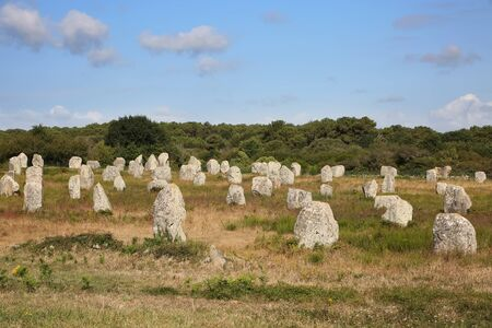 Photo pour Thousands of prehistoric standing stones spread across three alignments at Carnac, Brittany, northwest France. - image libre de droit
