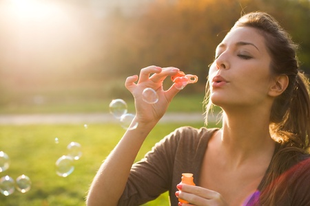 Blowin bubbles into the sun.