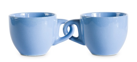 Photo pour Two for the price of one cups, concept on blue coffe cops with interlocked handles. - image libre de droit
