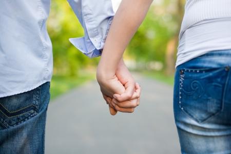 Photo pour Closeup shot of young couple holding hands.  - image libre de droit