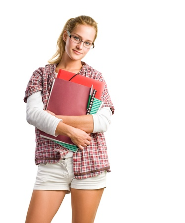 Portrait of pretty young student girl holding exercise books and folder isolated on white background.