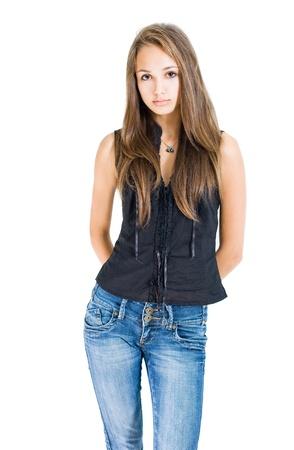Foto de Portrait of fashionable young brunette model in blue jeans and black top. - Imagen libre de derechos