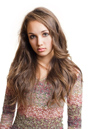 Portrait of a striking beautiful young brunette girl with emotional facial expression.