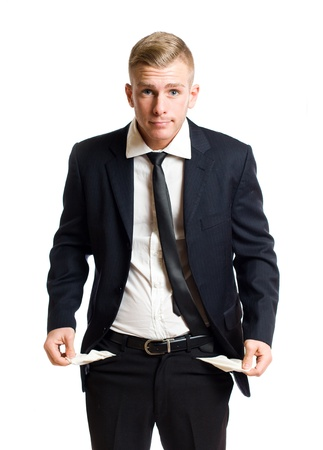 Handsome young businessman displaying empty pockets