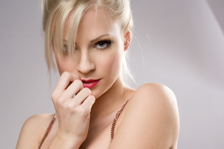 Portrait of a sensual seductive young blond woman.