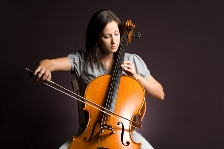 Passionate real artist, young woman playing her classical instrument.