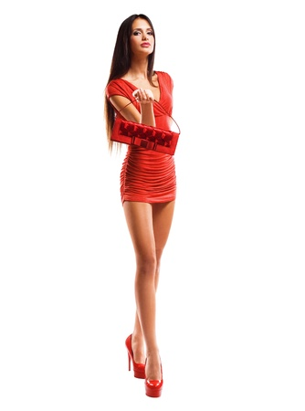Whole figure shot of gorgeous sensual slender model in little red dress.