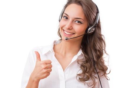 Portrait of smiling friendly office girl wearing headset.