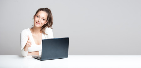 Portrait of a young brunette beauty with her laptop.