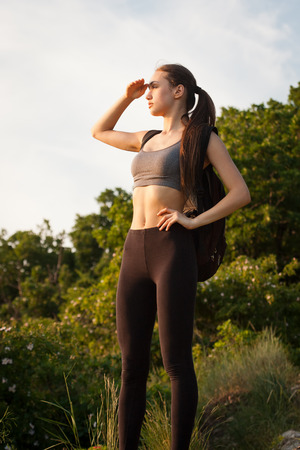 Portrait of a fit fit young brunette woman outdoors.