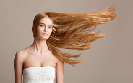 Foto de Portrait of a beautiful young blond woman with amazing flowing hair. - Imagen libre de derechos