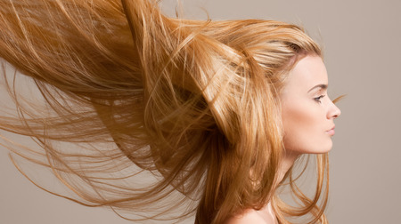 Photo for Portrait of a beautiful young blond woman with amazing flowing hair. - Royalty Free Image