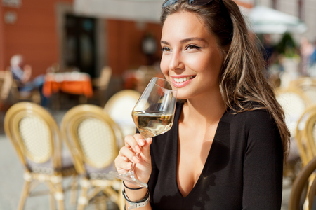 Photo for Outdoors portrait of a beautiful wine tasting tourist woman. - Royalty Free Image