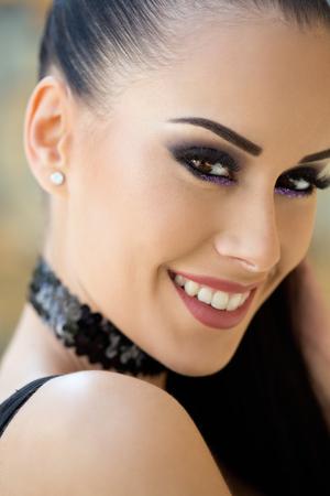 Foto de Gorgeous fashionable young brunette woman in heavy dark makeup. - Imagen libre de derechos