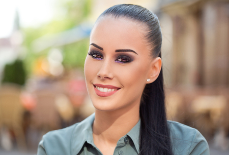 Photo for Gorgeous fashionable young brunette woman in heavy dark makeup. - Royalty Free Image