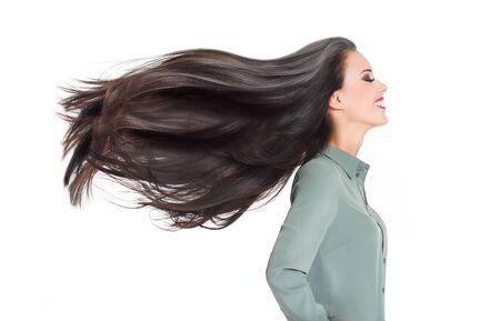 Photo pour Portrait of a brunette beauty showing off amazing long hair. - image libre de droit