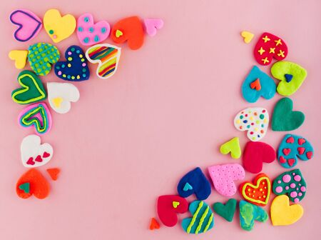 Photo pour Colorful handmade plasticine hearts on pink background - image libre de droit