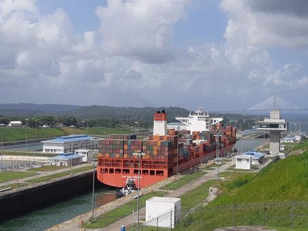 Cargo container ship crossing Panama canal. Panama canal / Panama.