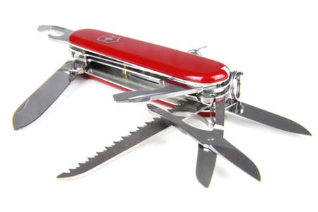 Opened red swiss army knife isolated on white background