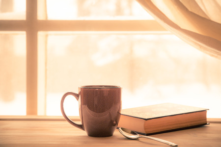Foto de Coffe and Book near window with bright sunny light - Imagen libre de derechos