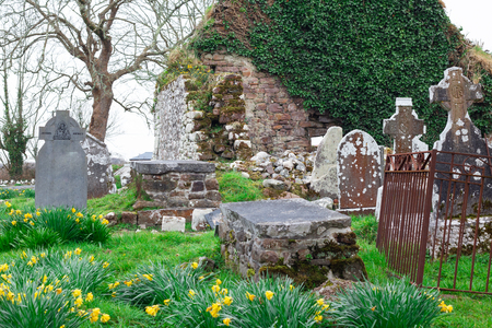 View of old Irish cemetery ruins in countryside of Ireland