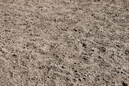 Background of ploughed up soil field