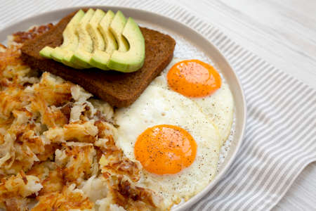 Photo pour Tasty Homemade Fried Hashbrowns and Eggs on a plate, low angle view. Copy space. - image libre de droit