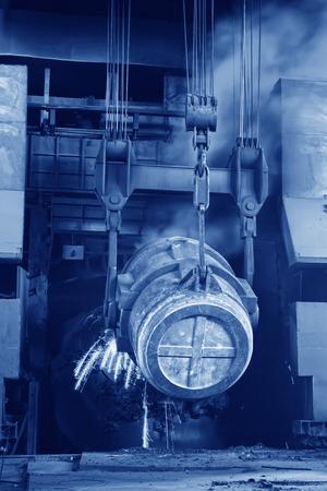 steel mills converter filling materials, closeup of photo