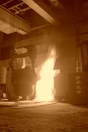 TANGSHAN - JUNE 20: converter plus iron material in iron and steel co., on June 20, 2014, Tangshan city, Hebei Province, China