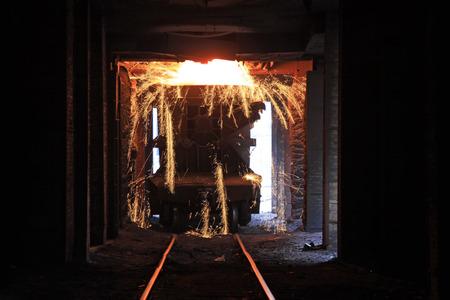 TANGSHAN - JUNE 20: Transportation molten iron crucible train, on June 20, 2014, Tangshan city, Hebei Province, China