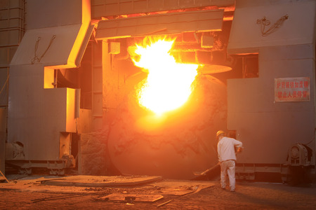 TANGSHAN - JUNE 19: steel mills converter workers tense work, on June 19, 2014, Tangshan city, Hebei Province, China