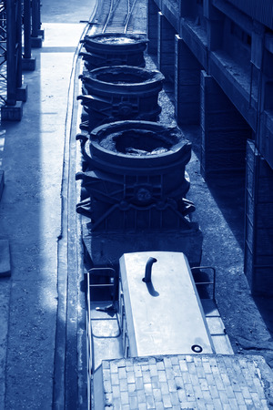TANGSHAN - JUNE 14: Transportation molten iron crucible train, on June 14, 2014, Tangshan city, Hebei Province, China