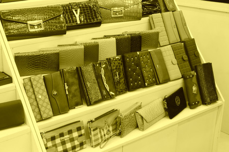 TANGSHAN - NOVEMBER 16: Color wallets were put on the shelf in a store, on November 16, 2013, tangshan city, hebei province, China.