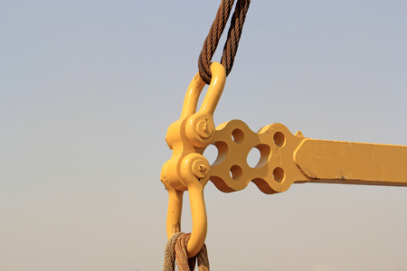 yellow metal fasteners and wire rope, closeup of photo