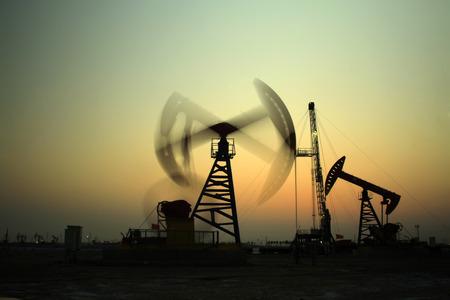 Crank balanced beam pumping unit in Jidong oilfield sunset scenery, Hebei Province, China