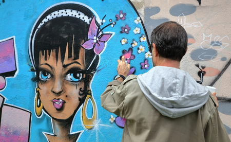 SOKOA,FRANCE-MAY 16, 2015: Local artists decorate the walls of the port area on May 16, in Sokoa, France.