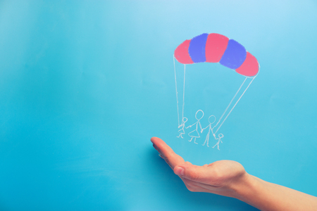 Photo for Social protection concept. family on the parachute - Royalty Free Image