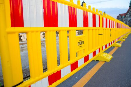 Photo pour Yellow construction border in the city. Close up - image libre de droit