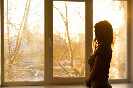 Photo for Silhouette of a woman near window. Early morning. Sunrise - Royalty Free Image