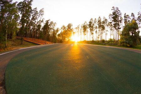 Photo pour Sunlight over sport ground in a park - image libre de droit