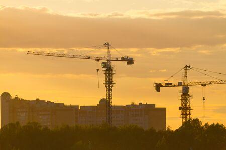 Photo pour construction site on sunset in yellow sunlight - image libre de droit