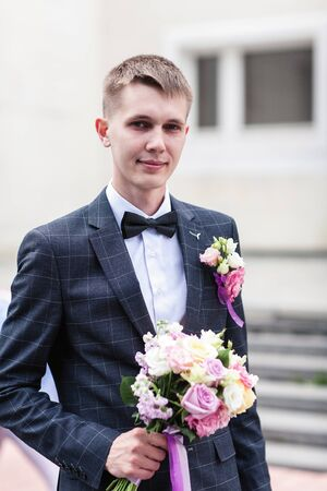 Photo for groom with a bouquet of wedding flowers - Royalty Free Image