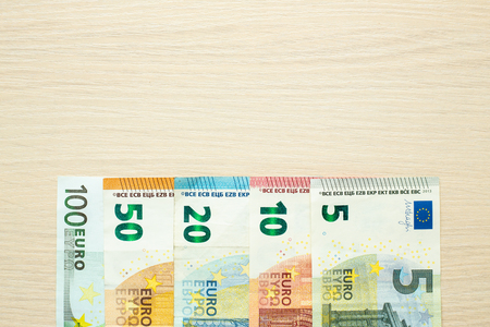 Euro banknotes on the table. Top view.